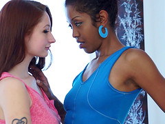 An ebony babe and a white girl have an interracial lesbian hook up