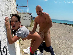 Sassy brunette doll getting hammered outdoor by the beach