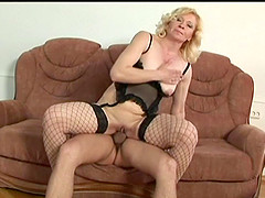 Ravishing mature amateur pornstar in sexy fishnet stockings gets fucked doggy style